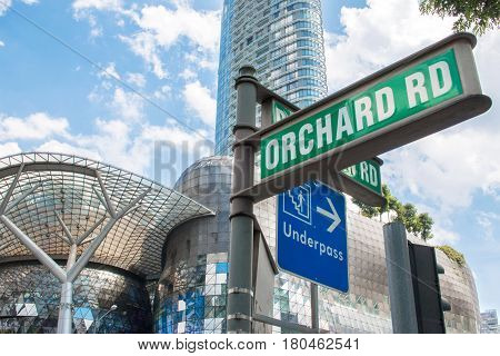 SINGAPORE - MAR 21 2017 : Street sign or traffic sign of Orchard Road with underpass sign for tourist. The famous shopping main street Orchard Road area in Singapore.