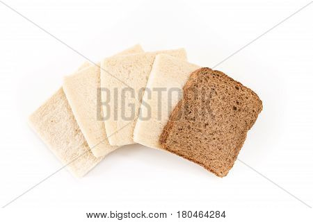 White No Crust Sandwich Bread Slices With One Of Them Wholesome Brown, On White Background.