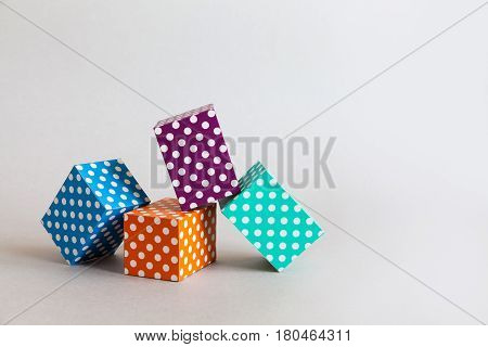 Modern geometrical design template. Abstract colorful blocks polka dot pattern. Violet green orange blue color rectangular boxes arranged on gray background. Copy space photo.