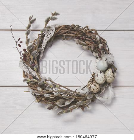 Easter Wreath With Willow And Eggs On Wooden Background