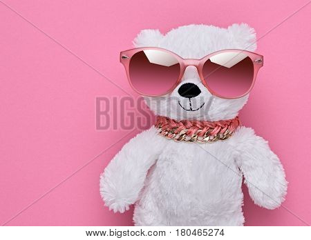 Fashion Teddy Bear Having Fun. Stylish Luxury Outfit. Hipster Playful Teddy Bear in Fashion Sunglasses, Glamour Pink Colors. Party Night Out Look. Cheeky Emotions, Trendy fashion pink. Minimal
