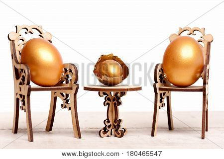 Easter Golden Egg On Wooden Chair At Table, Future Life