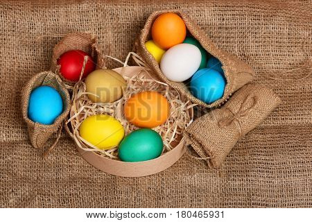 Easter Colorful Eggs In Burlap Sack And Box