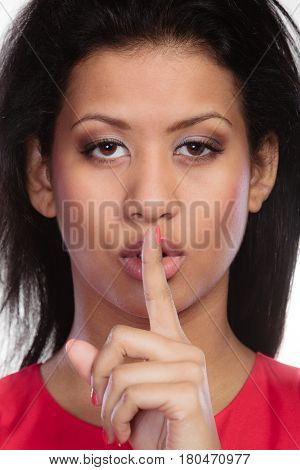Secret woman finger on lips. Teen girl mixed race showing hand silence sign saying hush be quiet
