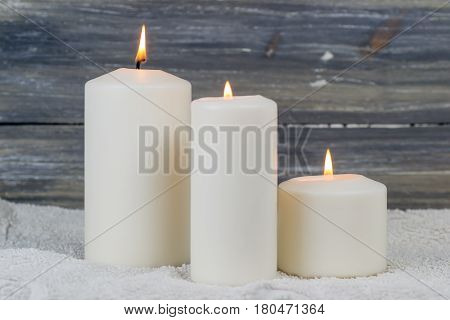 a candle is lit in the darkness and gives spiritual warmth