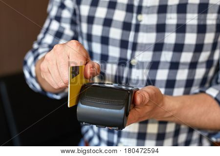 Male Hands Using Payment Terminal Paying With Credit Card, Finance Concept