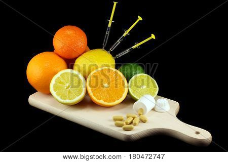 A vitamin overdose arrangement of fruits and pills concept