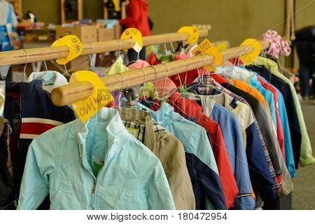 Childrenswear sorted by size at a bazaar