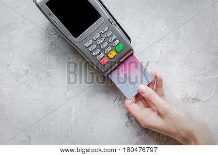 purchase with payment terminal by credit card on stone desk background top view mockup