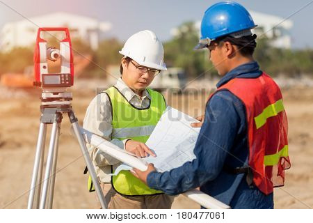 Asian Construction engineer and Asian foreman worker checking construction site for new Infrastructure construction project