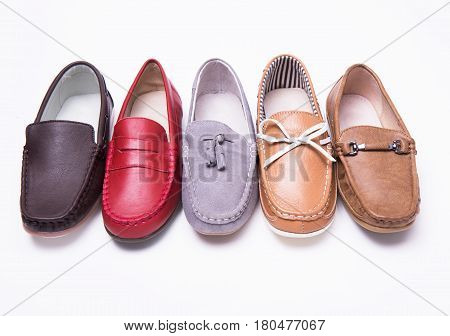 Different moccasins for a boy on a white isolated background