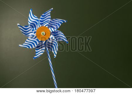 Blue and white pinwheel over dark green effect