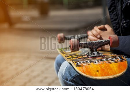 young skateboarders legs skateboarding at skatepark outdoors