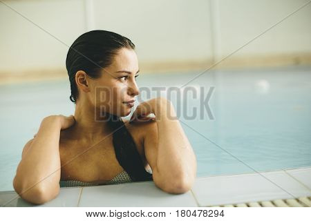 Young Woman By The Swimming Pool In The Spa Center