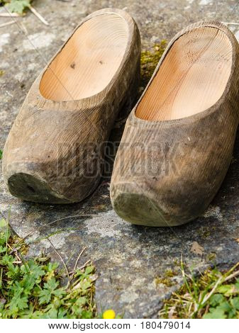 Regional tradition and culture handmade concept. Closeup of wooden dutch shoes traditional clogs footwear