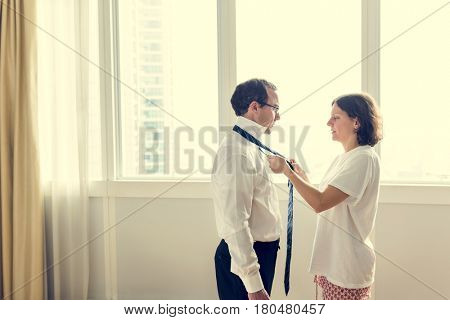 Wife Wearing Necktie to Husband Routine Life