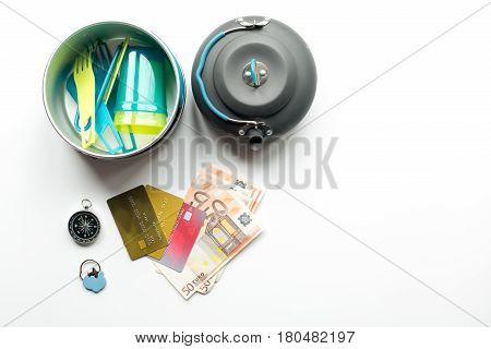 Traveler's accessories and credit cards in vacation concept on white table background top view