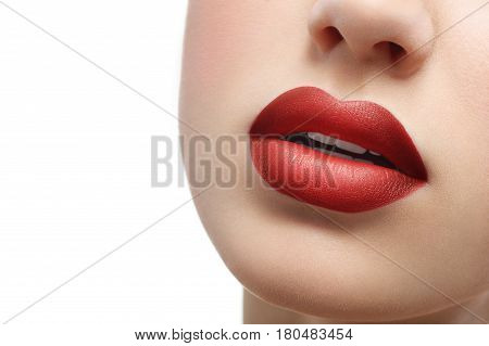 Cropped close up of full sexy sensual lips of a beautiful woman. Red lipstick on sexy plump lips isolated on white copyspace makeup visage sexuality femininity beauty face cosmetics fashion concept