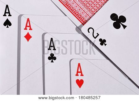 A combination of four aces in the card game poker
