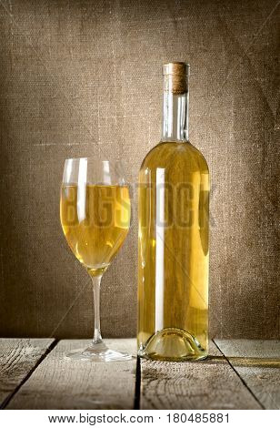 Dessert wine on the background of the canvas