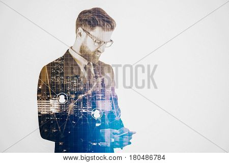 Thoughful businessman using smartphone on abstract city background with forex chart. Business concept. Double exposure
