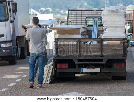 longshoreman unloading a truck in the street