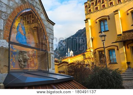 Neuschwanstein and details of Hohenschwangau Castle in Germany, Bavaria, mountains view