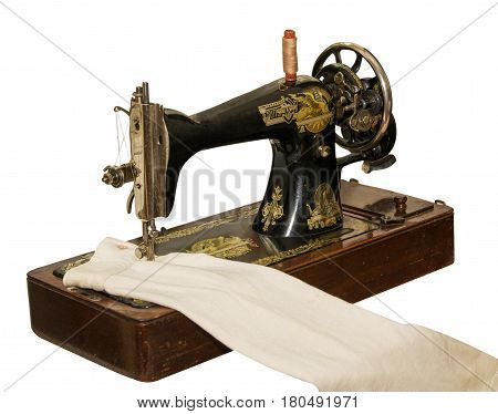 Vintage sewing machine. Old sewing machine isolated on white background .