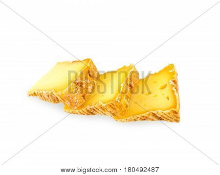 Three soft washed-rind cheese slices isolated on white