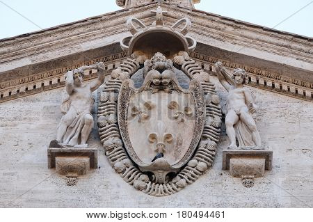 ROME, ITALY - SEPTEMBER 02: Coat-of-arms of France on the facade of Chiesa di San Luigi dei Francesi - Church of St Louis of the French, Rome, Italy on September 02, 2016.