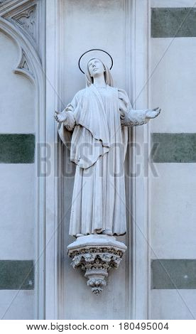 ROME, ITALY - SEPTEMBER 02: Statue of St. Margaret Mary Alacoque on the facade of Sacro Cuore del Suffragio church in Rome, Italy  on September 02, 2016.