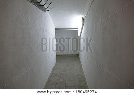 Claustrophobic Narrow Corridor With Poor Light