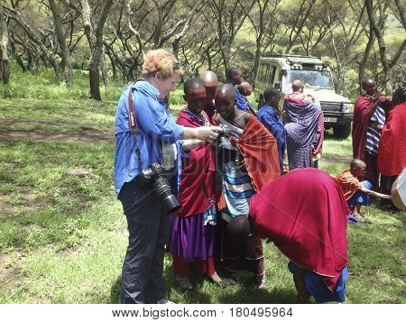 Tourist With Girls From Maasai Village, Ngorongoro Conservation Area, Tanzania