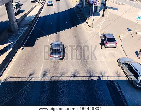 Traffic in a big city on a bridge cityscape