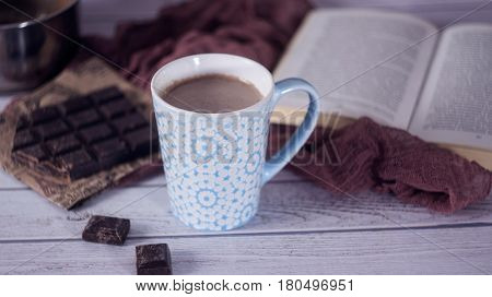 Blue Cup Of Hot Cocoa With Pieces Of Chocolate