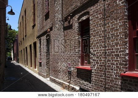 Brick buildings line a typical alley in the southern city of Charleston, South Carolina