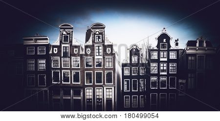 Front view of Amsterdam traditional houses cityscape in cold temperature with dark oval vignette effect