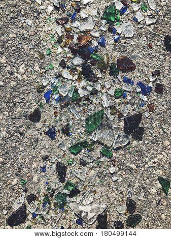 A lot of broken color bottle. Glass garbage background