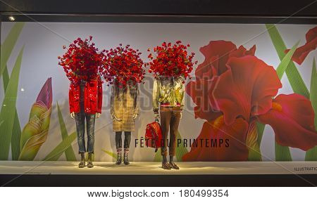 PARIS FRANCE - MARCH 27 2017: Mannequins in the showcase of the Printemps department store in Paris France. Spring and summer theme.
