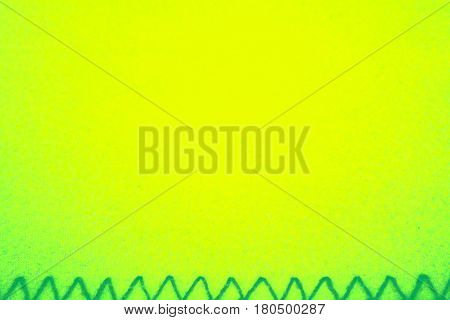Bright lemon yellow empty background texture with criss cross green knitting below