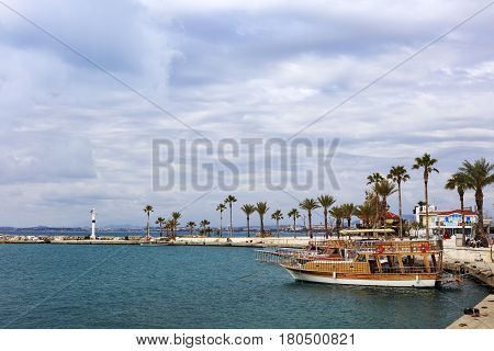 SIDE, TURKEY - MARCH 10: Small harbor and light house in the old town of Side, Antalya province on March 10, 2017.