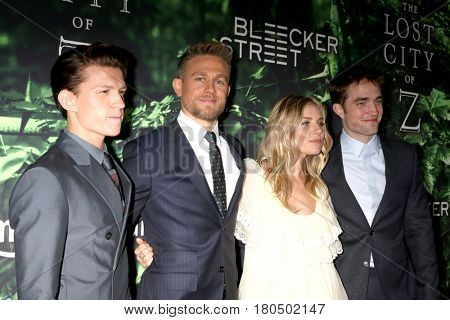 LOS ANGELES - APR 5:  Tom Holland, Charlie Hunnam, Sienna Miller, Robert Pattinson at the