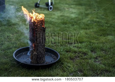 Swedish torch fire burning stub on a plate for rest or to cook food chill mood poster