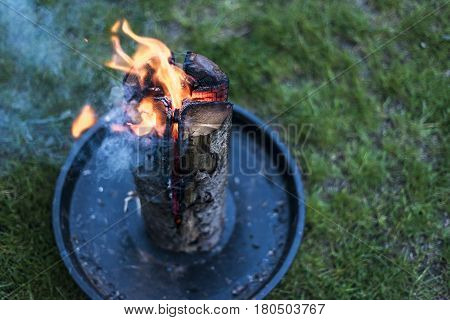 Swedish torch fire burning stub on a plate for rest or to cook food chill mood