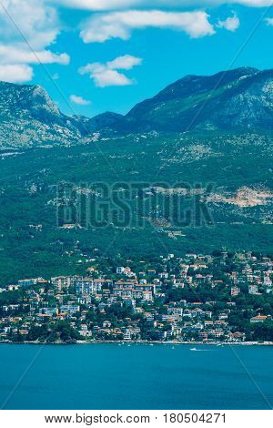 Herceg Novi, the view from the shore on the contrary, against the background of mountains and sky, Montenegro, Adriatic
