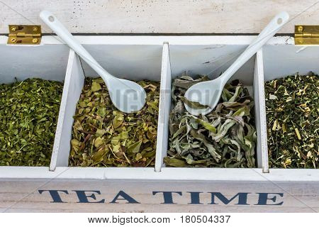 `TEA TIME` box with dried herbs and two white porcelain tea spoon