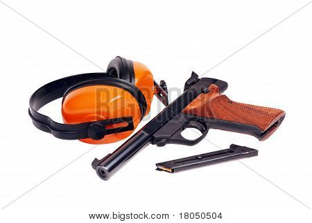target pistol and hearing protectors