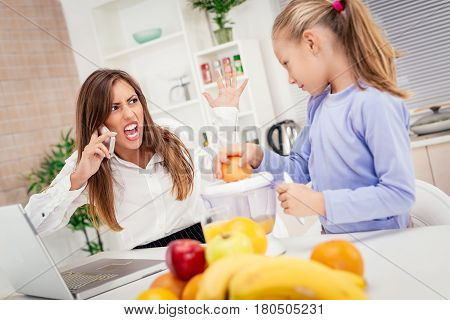Stressed Businesswoman And Her Daughter In The Morning At Home