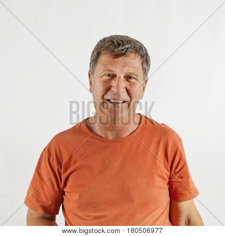 portrait of smiling mature man isolated on white