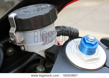 Motorcycle brake oil level and preload screw